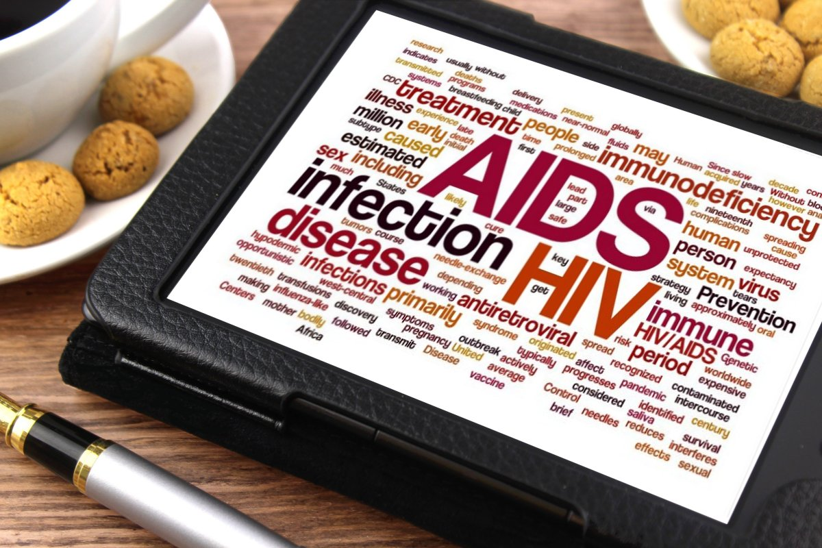 "Photo of a tablet displaying a ""word cloud"" that includes the words AIDS, HIV, infection, disease, etc."