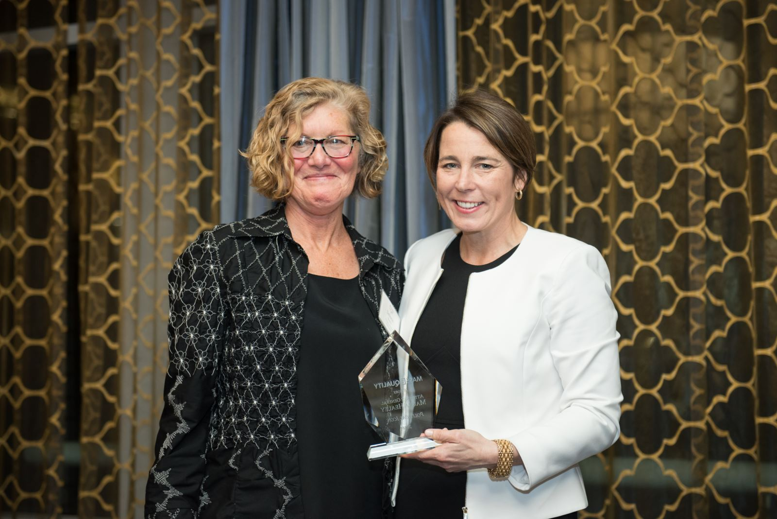 MassEquality Executive Director stands next to MA Attorney General Maura Healey at the 2018 Icon Awards