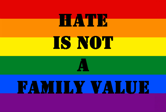 "Rainbow flag with ""Hate is not a family value"" written on it"