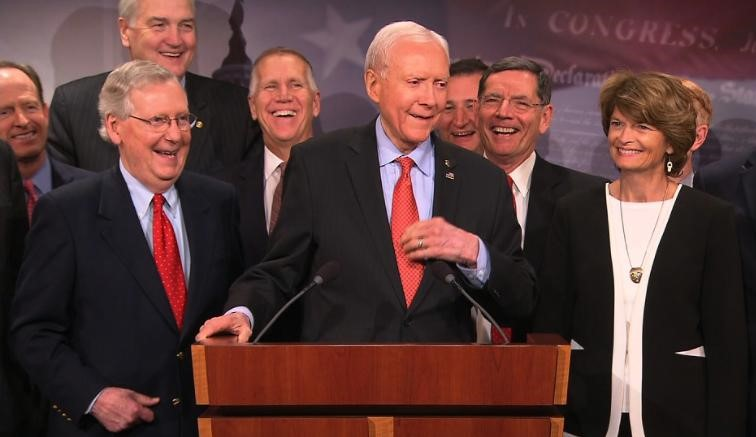 Senate Republicans celebrate the passage of their tax scam. Photo: CNN